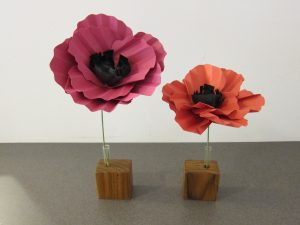 Red poppies standing in wood block vases