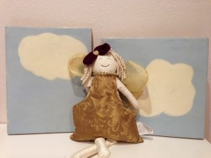 Doll in front of the clouds
